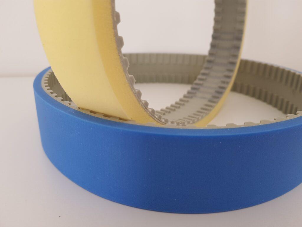 Cinghie dentate rivestite in Sylomer giallo e Sylodin blu